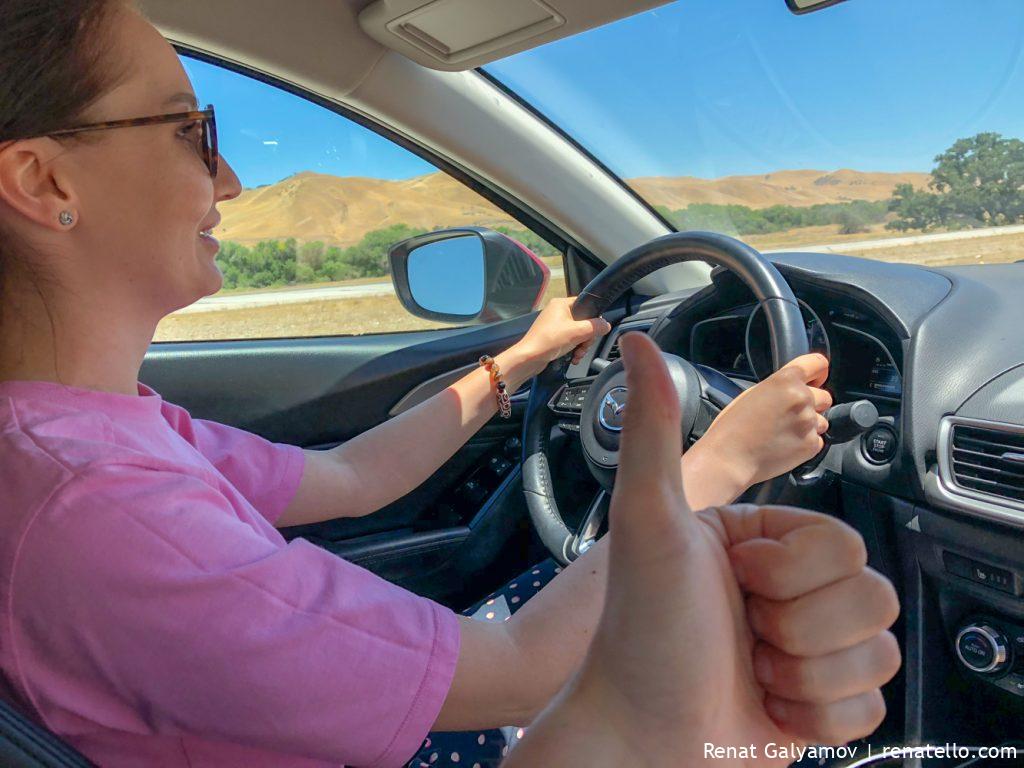 Amina driving a car in California